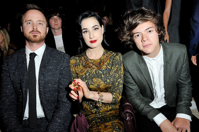 Dita Von Teese (centre) with Aaron Paul (left) and Harry Styles (right) at the Burberry SS13 show
